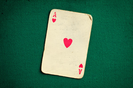 card game: the antique card on green casino table Stock Photo