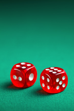 the red casino dice on green table