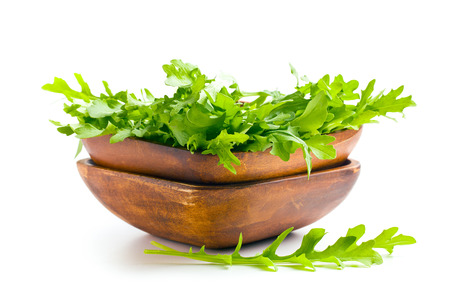 the arugula leaves in wooden bowl photo