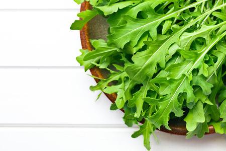 the fresh arugula leaves on plate