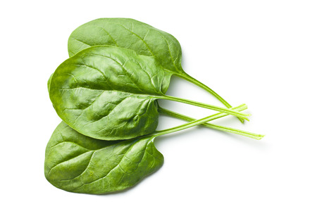 spinach: green spinach leaves on white background