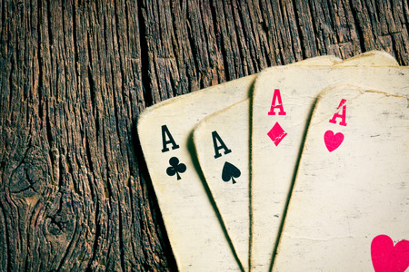 games of chance: the old cards on wooden table