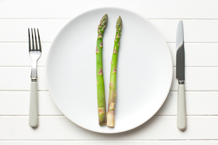 top view of green asparagus on white plate photo