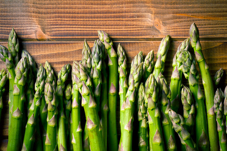 wooden table top view: top view of green asparagus on old wooden table