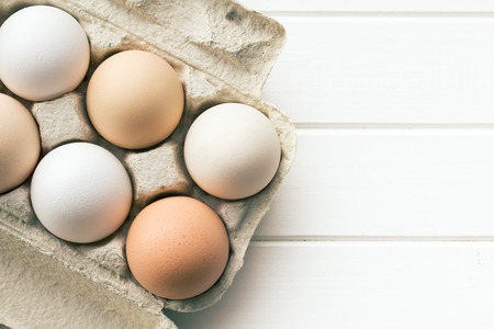 top view of chicken eggs in egg box photo