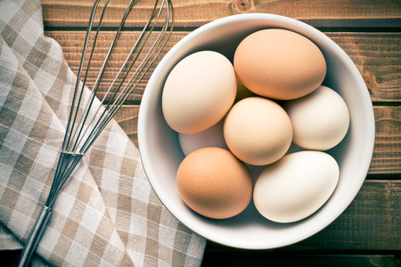 breakfast eggs: top view of eggs in bowl Stock Photo