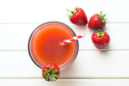 top view of strawberry juice in glass photo