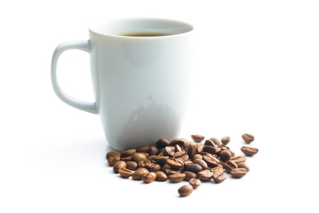 coffee cup and coffee beans on white background photo