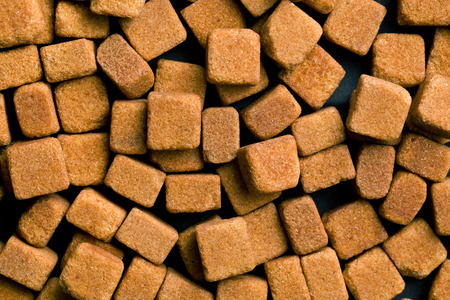 sugar cube: background made from brown sugar cubes Stock Photo