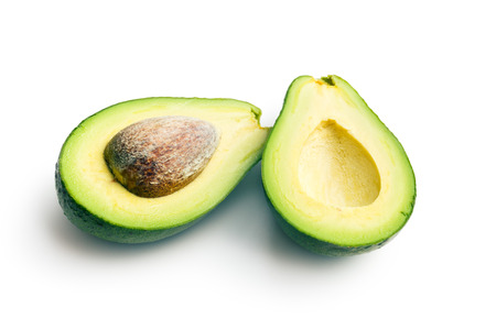 halved avocados on white background photo