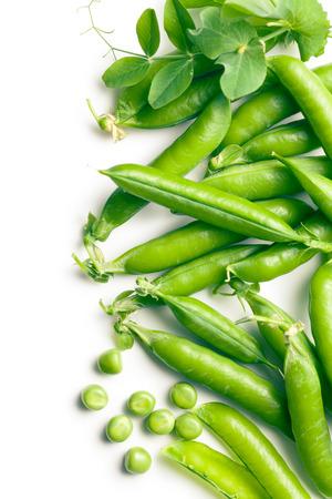 green peas: green pea pods on white background Stock Photo