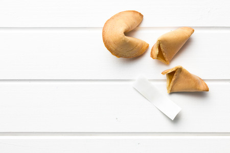 good fortune: top view of fortune cookie on white table Stock Photo