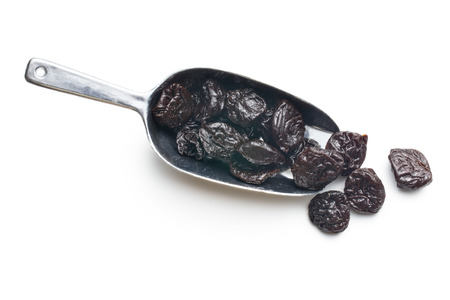 pitted prunes on white background