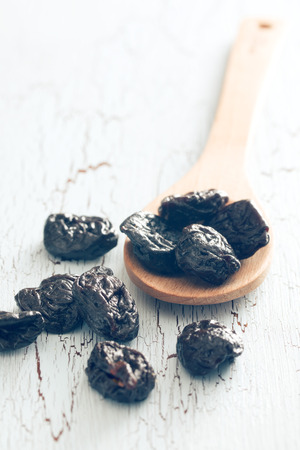 pitted: pitted prunes on old table Stock Photo