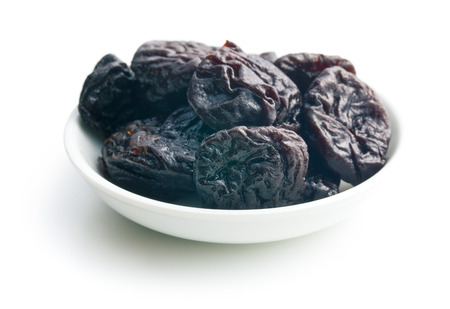 pitted: pitted prunes on white background