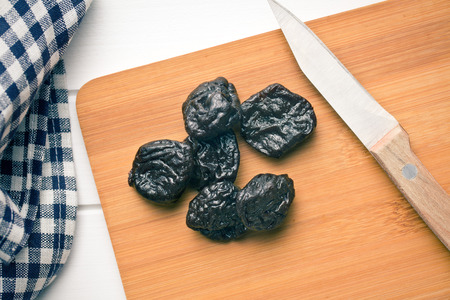 pitted: pitted prunes on cutting board