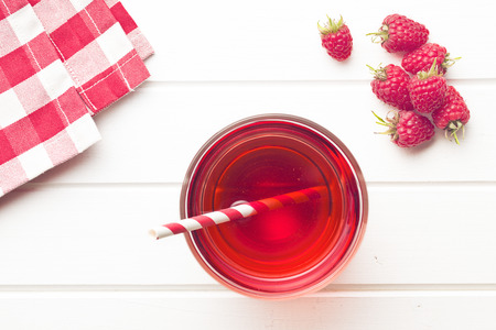 raspberry juice on white table Stock Photo