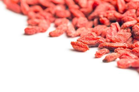 dried goji berries on white background photo