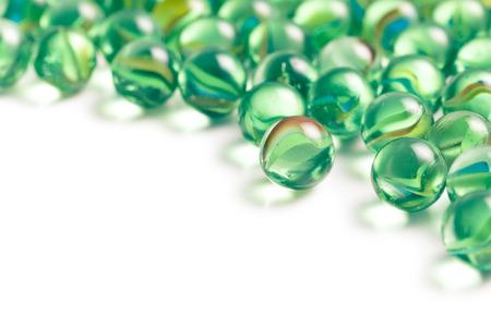 Glass marble balls on white background photo