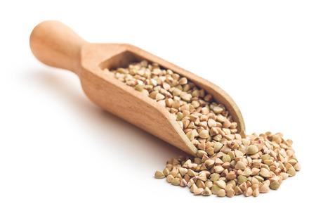 uncooked buckwheat in wooden scoop photo