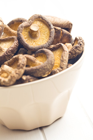 shiitake: dried shiitake mushrooms in bowl Stock Photo