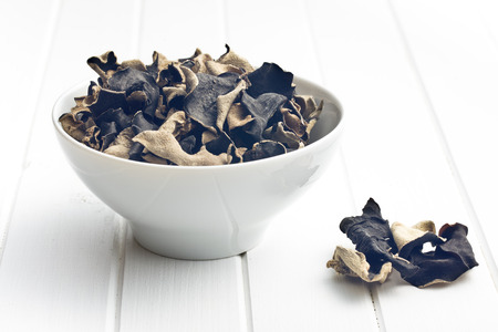 Dried chinese black fungus. Jelly ear in bowl.