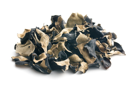 Dried chinese black fungus. Jelly ear on white background. Banco de Imagens