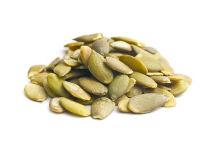 pumkin seeds on white background 스톡 콘텐츠