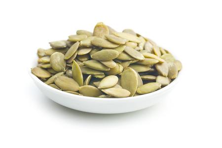 pumkin seeds on white background Stockfoto