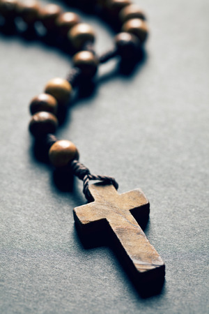 black gods: wooden rosary beads on black background Stock Photo