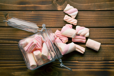 top view of sweet marshmallow on wooden table