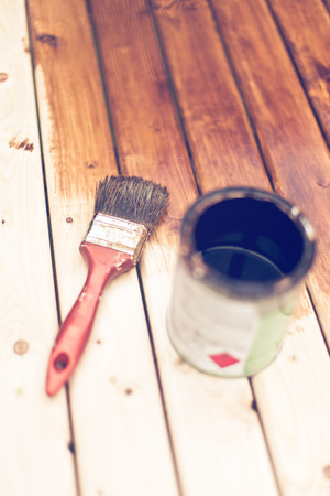 modernise: painting a wooden table using paintbrush  Stock Photo