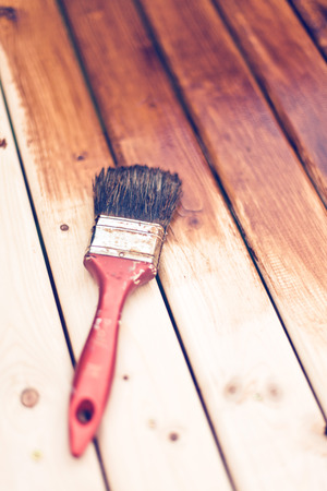 painting a wooden table using paintbrush  Stock Photo