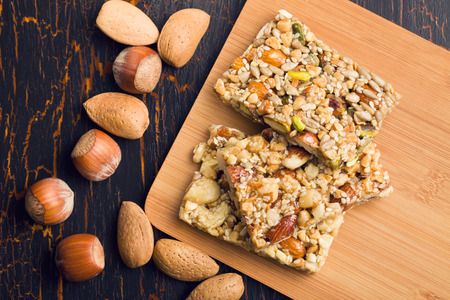 cereal bar: tasty nut bar on table Stock Photo