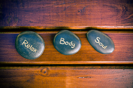 the spa stones on wooden background