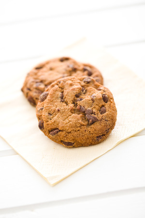 unhealthy diet: chocolate cookies on white table Stock Photo