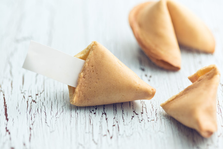 fortune cookie: the fortune cookie on the cracked table Stock Photo