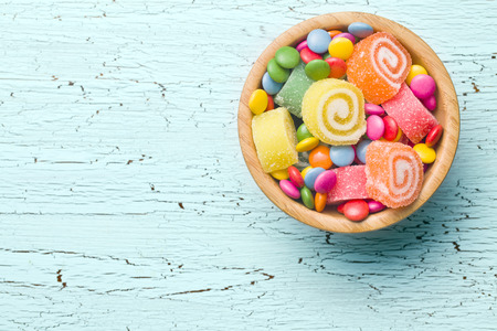 lollipop: top view of colorful candy on old table