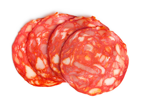 top view of sliced chorizo salami on white background photo