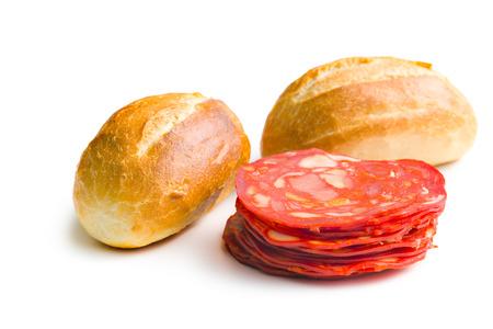 salami sausage: sliced chorizo salami and buns on white background Stock Photo