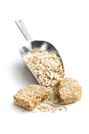 wholemeal crackers with oatmeal on white background photo