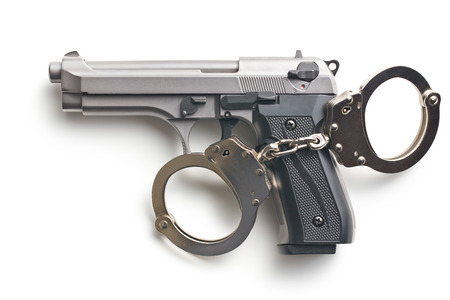gun and handcuffs on white background photo