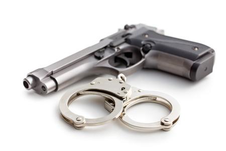 handgun: gun and handcuffs on white background Stock Photo