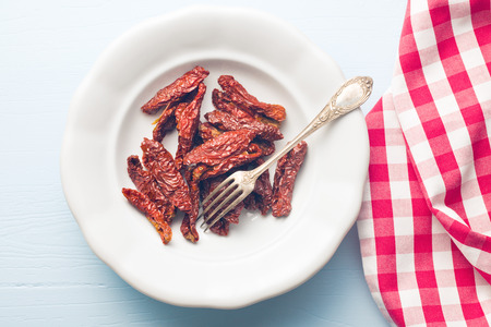 sun dried: top view of sun dried tomatoes in plate Stock Photo