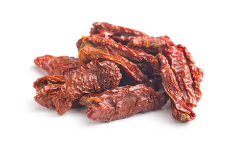 sundried: sun dried tomatoes on white background