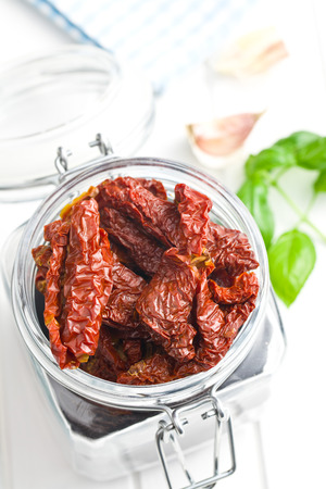 sun dried tomatoes on glass jar
