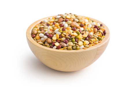 mixture of legumes in wooden bowl photo