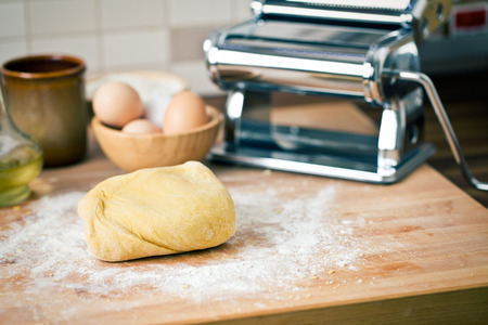 machine made: raw dough on wooden desk