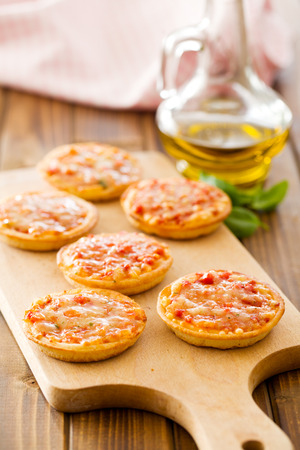 mini pizza: the mini pizza on cutting board