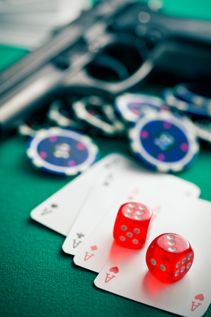 dices and aces on green table photo